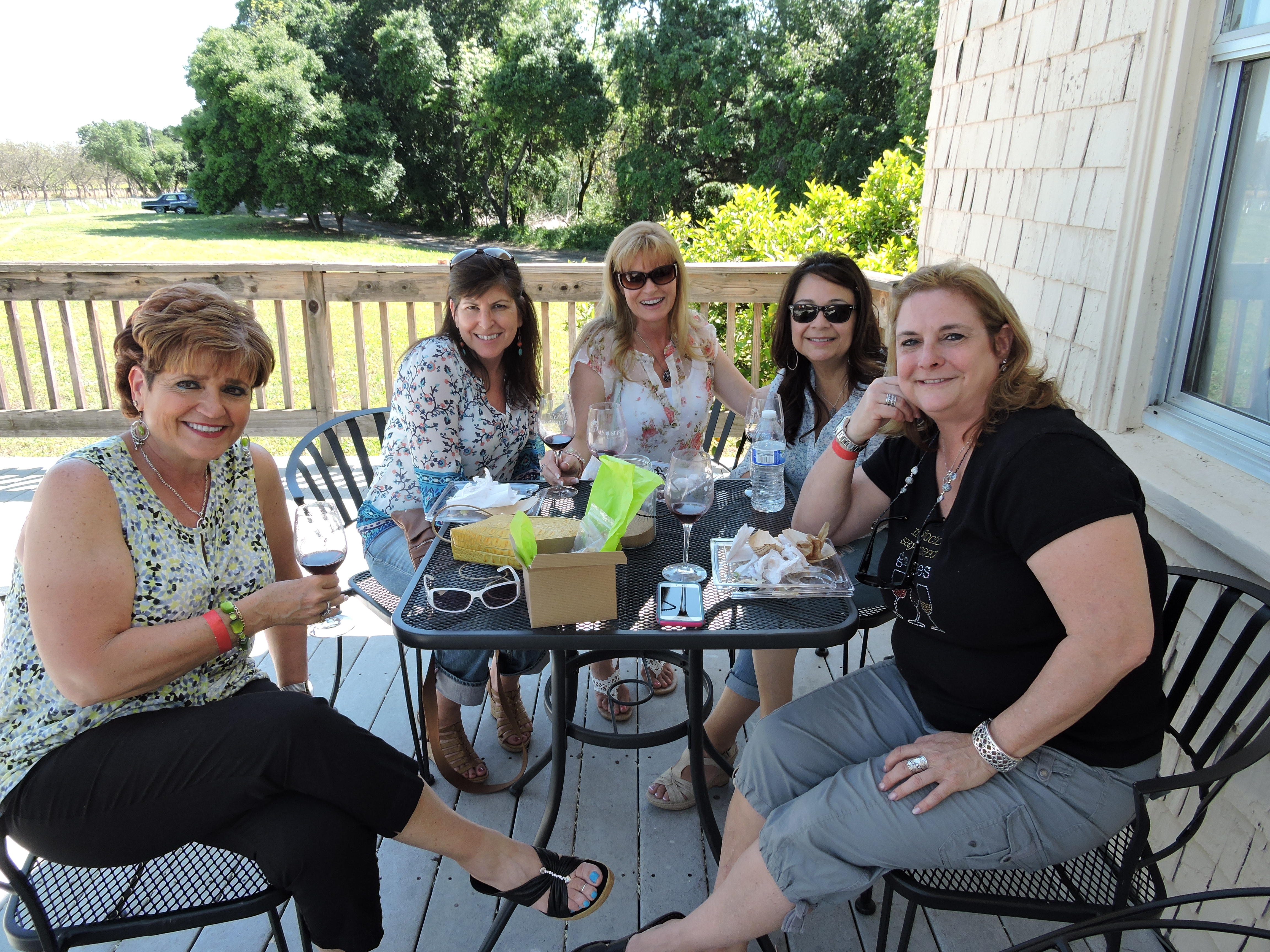 A group of friends enjoy great company and delicious wine at BackRoad Vines.