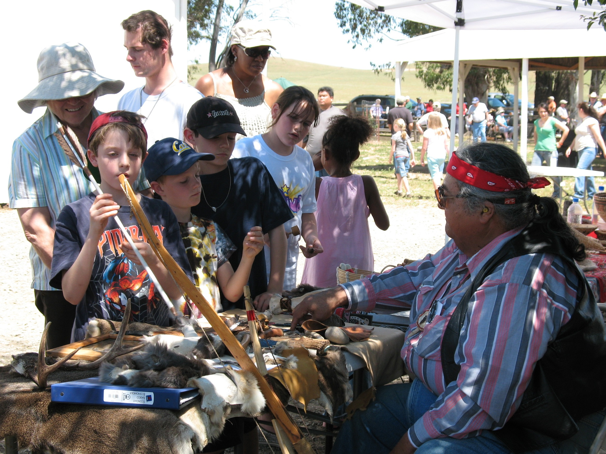 Little Bear showing handcrafted tools at Rush Ranch Open House_Courtesy of Rush Ranch Educational Council