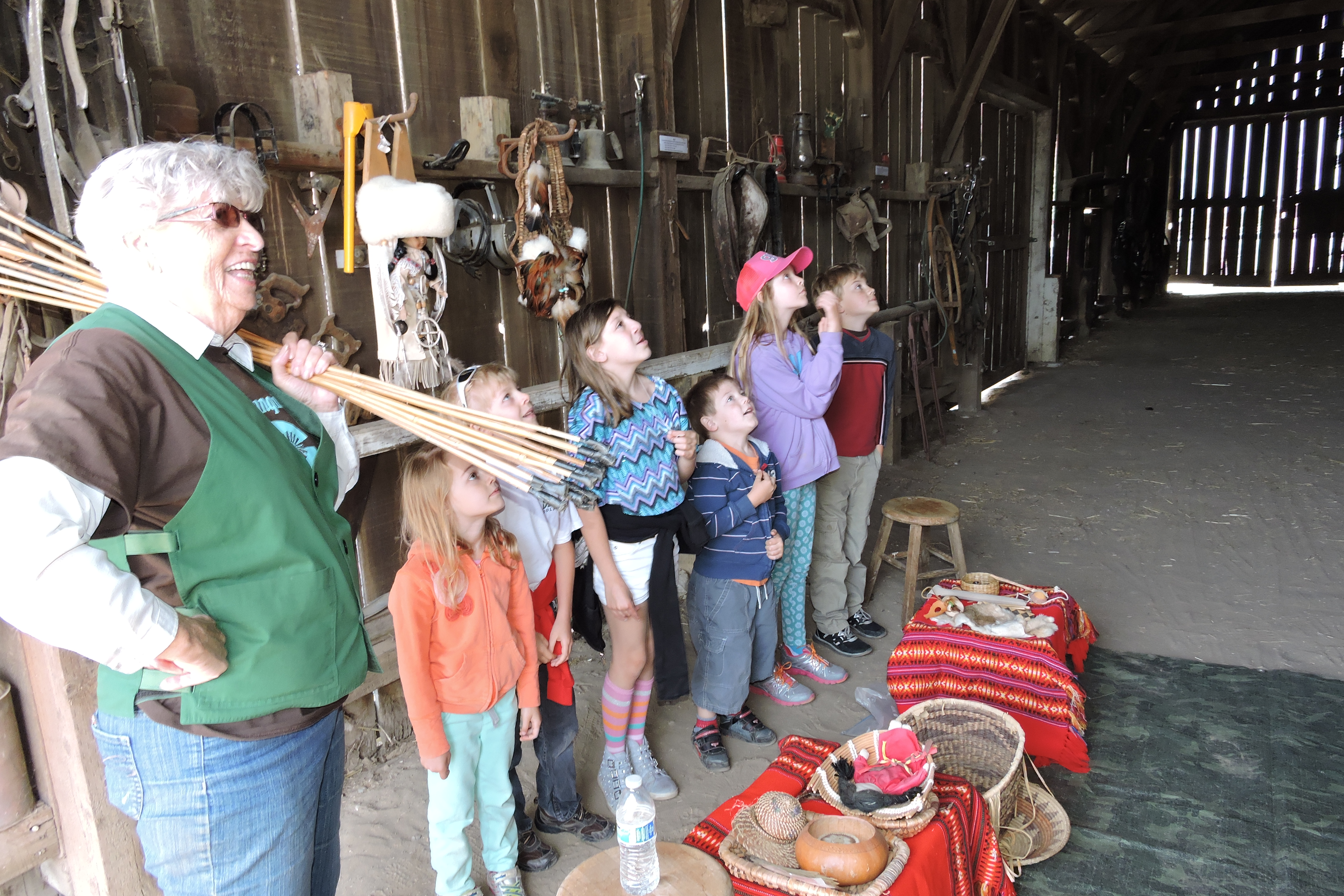 Children from Heritage Peak Charter School in Vacaville react as they spot the two barn owls residing in the Rush Ranch barn