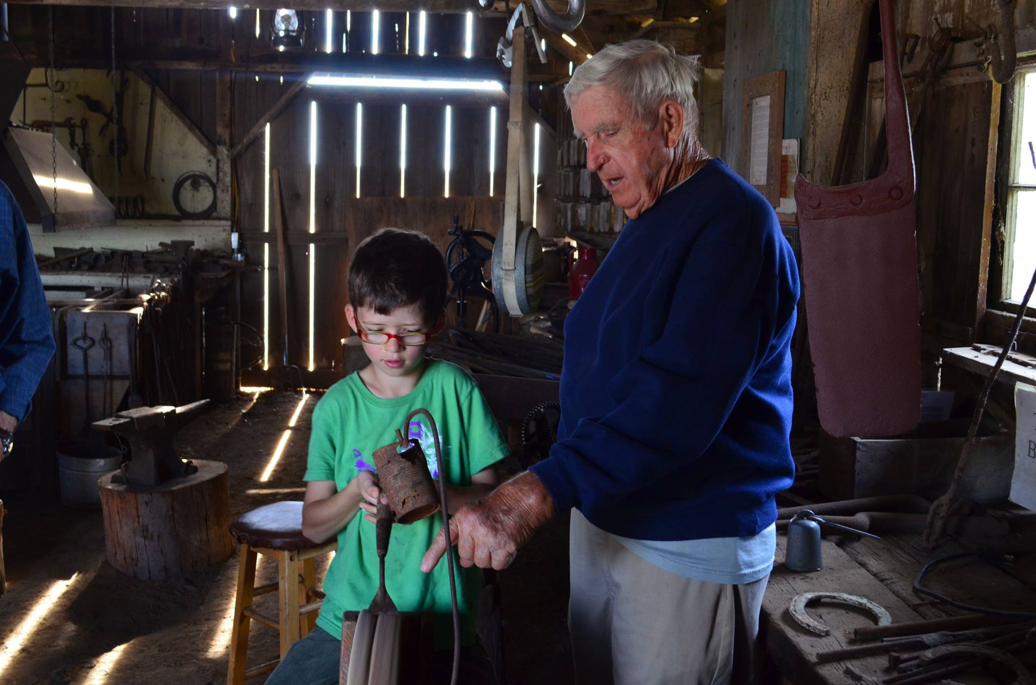 Long time volunteer, Virgil Sellers, in the blacksmith shop at Rush Ranch. Photo by Nicole Byrd.