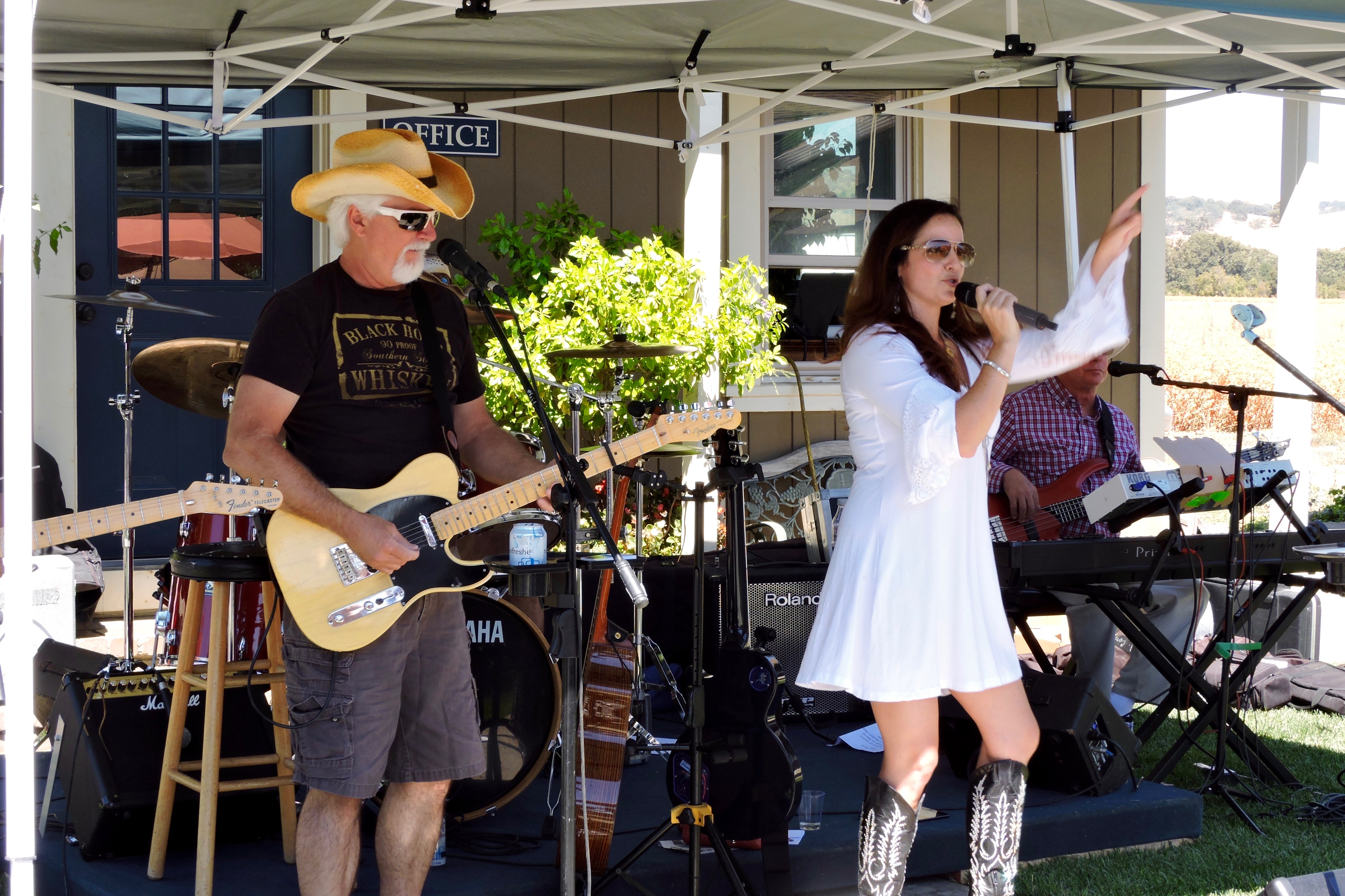 In between the grape stomping, Whiskey & Honey performed for the Harvest Celebration crowd at Wooden Valley Winery.